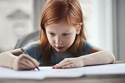 Red hair girl writing