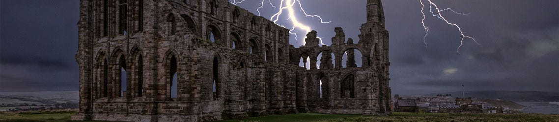 Whitby Abbey in stormy skys with lightning strike
