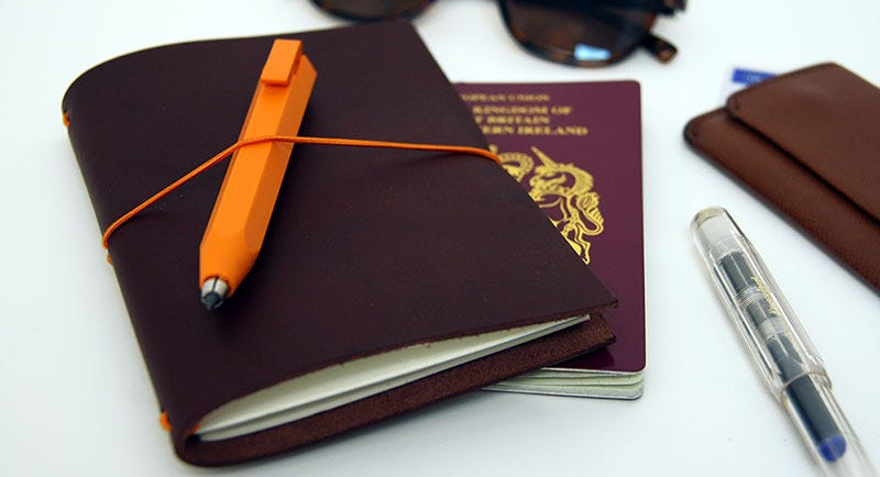 Budget Travel Essentials: Paper Republic Grand Voyageur Travel Notebook in Chestnut & Worther Shorty Pencil in Orange