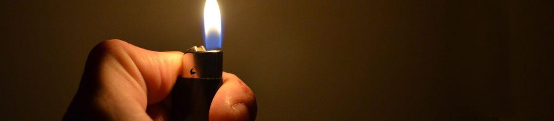 Hand holding lit lighter