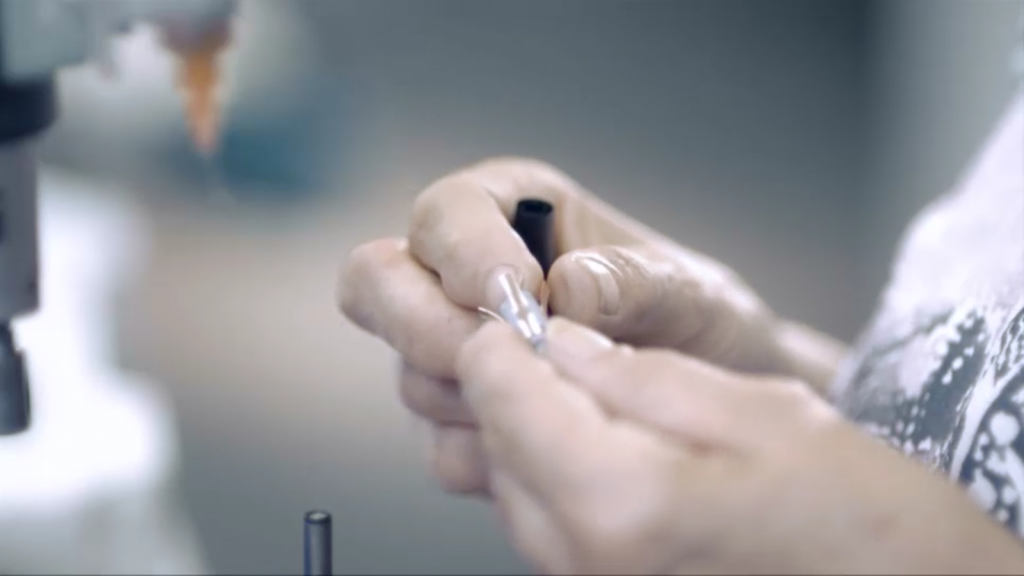 the finer stages of pen assembly are carried out by hand