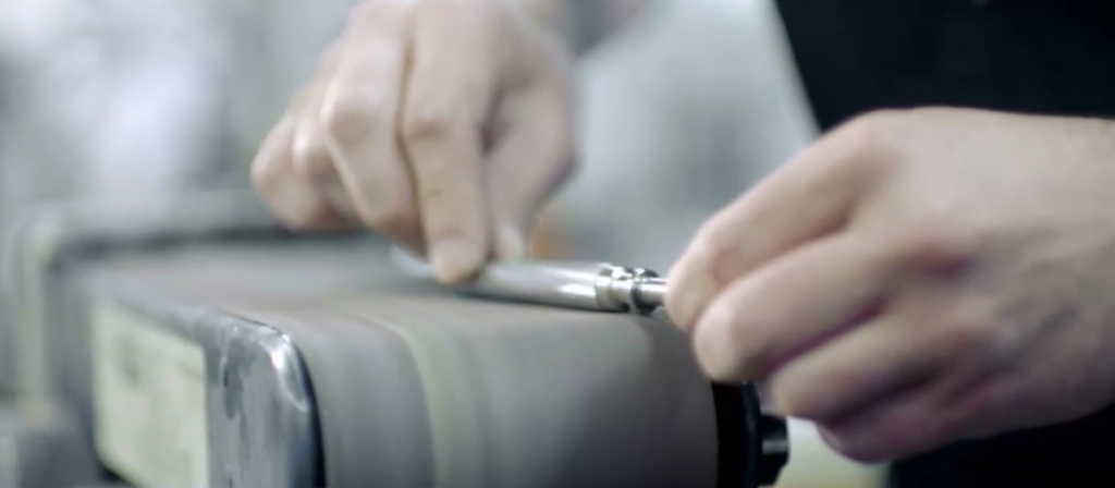 a prototype pen being handmade by a skilled engineer