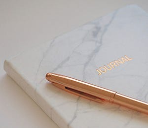 Marbled journal with rose gold pen