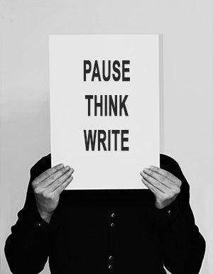 Man holding sign saying Pause, Think, Write