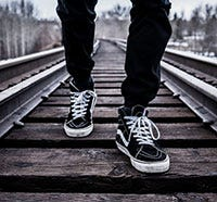 Person walking on train tracks