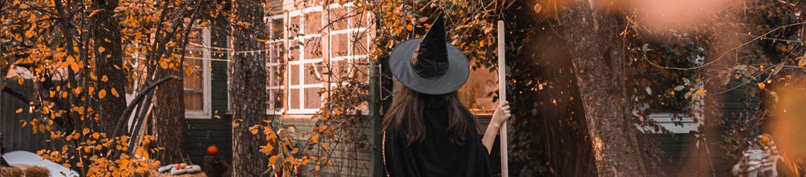 Autumn scene with lady in witches costume