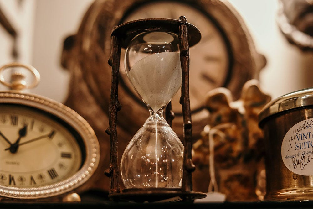 Antique clocks and hourglass